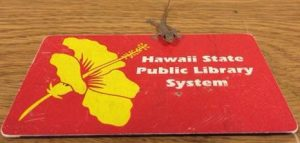 Red library card with a gecko on top