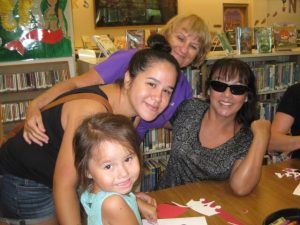 Family of four women posing at storytime