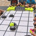 Children playing robotics soccer